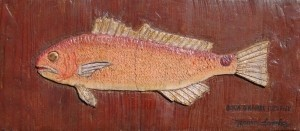 Sanchez, Mario. Boca Grande Redfish. Carved oil on board, 7 one half by 16 three quarters inches.